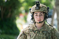 U.S. Army female soldier in uniform outdoors