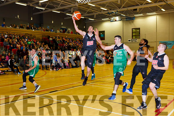 Dan Griffin Scotts Lakers lays up for a basket against Ciarn Woods Limerick Celtics in Killarney Saturday night