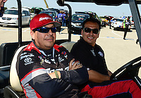 Sept. 22, 2012; Ennis, TX, USA: NHRA funny car driver Cruz Pedregon (near) with his brother Tony Pedregon during qualifying for the Fall Nationals at the Texas Motorplex. Mandatory Credit: Mark J. Rebilas-US PRESSWIRE
