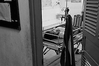Health center Cambodia . A woman has just given birth and is resting in the delivery room of Trapeng Andeuk health center. Trapeng Andeuk, Takeo province, Cambodia-2009