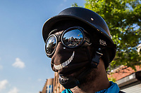 NEW YORK, NEW YORK - JUNE 03: A man cover his face  during a protest against the death of George Floyd on June 3, 2020 in Brooklyn, New York. Protests spread across the country in at least 30 cities across the United States, over the death of unarmed black man George Floyd at the hands of a police officer, this is the latest death in a series of police deaths of black Americans. (Photo by Pablo Monsalve / VIEWpress via Getty Images)