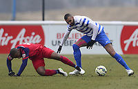Sandro of QPR wins the ball