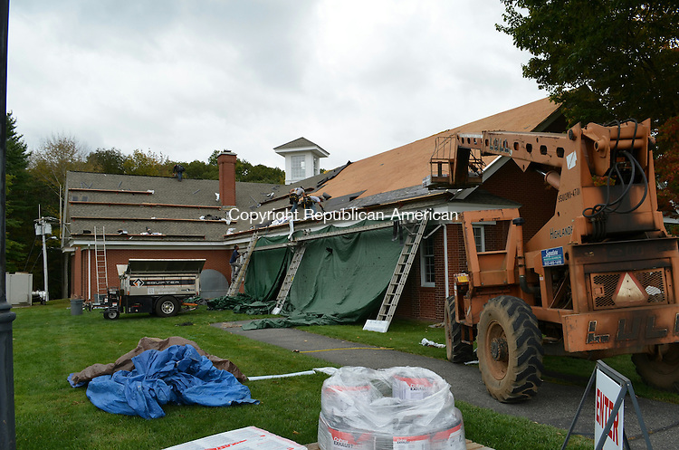 HARWINTON, CONN. -27 Sept 2013- 092713AG02- The roof of Town Hall took three days to complete. Workers replaced the roof, gutters and insulation on the building, which had been leaking for over five years. Alexa Gorman Republican-American