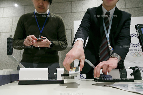 Members of staff collect old mobile phones from donors at Tokyo Metropolitan Government Building on February 21, 2017, Tokyo, Japan. Tokyo Government has asked for people to donate their old electronic gadgets (including smart phones, mobile phones and tablets) with the aim of collecting and recycling eight tonnes of gold, silver and bronze to make the 5,000 medals needed for the 2020 Tokyo Olympic and Paralympic Games. The recycling campaign started on Thursday, February 16. (Photo by Rodrigo Reyes Marin/AFLO)