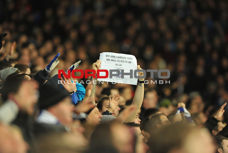 cardiff city fan holds up a sign which says'&quot; we are cardiff city we will always be blue &quot; -  28/12/2013 - SPORT - FOOTBALL - Cardiff City Stadium - Cardiff - Cardiff City v Sunderland - Barclays Premier League<br /> Foto nph / Meredith<br /> <br /> ***** OUT OF UK *****