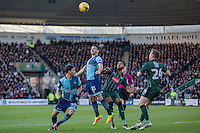 Matthew Bloomfield of Wycombe Wanderers wins a header against Jake Jervis of Plymouth Argyle during the Sky Bet League 2 match between Plymouth Argyle and Wycombe Wanderers at Home Park, Plymouth, England on 26 December 2016. Photo by Mark  Hawkins / PRiME Media Images.