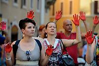 Roma, 24 Luglio 2018<br /> Decine di persone con le mani tinte di rosso a simboleggiare il sangue dei migranti morti in mare, protestano davanti Monte Citorio contro le politiche sull'immigrazione del Governo e del Ministro Salvini