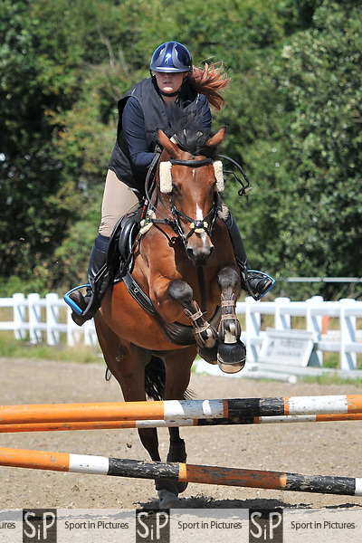 Stapleford Abbotts. United Kingdom. 18 August 2019. Class 5. Unaffiliated showjumping. Brook Farm training centre. Essex. UK.~ 18/08/2019.  MANDATORY Credit Ellen Szalai/Sport in Pictures - NO UNAUTHORISED USE - 07837 394578