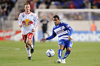 David Ferreira (10) of FC Dallas dends the ball forward. The New York Red Bulls defeated FC Dallas 2-1 during a Major League Soccer (MLS) match at Red Bull Arena in Harrison, NJ, on April 17, 2010.