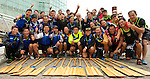 Vancouver, Canada, Aug 8th 2009. World Police and Fire Games, Dragon Boat Competition. An enthusiastic Hong Kong Police Dragon Boat team poses for a photo.  Their team won the  Grand Championship in the Mixed Open 20 and the Men's Open 20. They also took third in the Women's Open 10 Grand Championship.  Photo by Gus Curtis