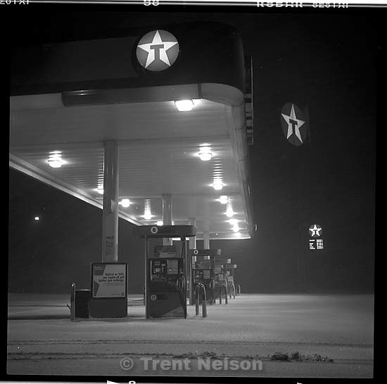 texaco gas station at night with snow