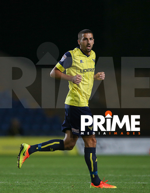 Liam Sercombe of Oxford United during the The Checkatrade Trophy match between Oxford United and Exeter City at the Kassam Stadium, Oxford, England on 30 August 2016. Photo by Andy Rowland / PRiME Media Images.