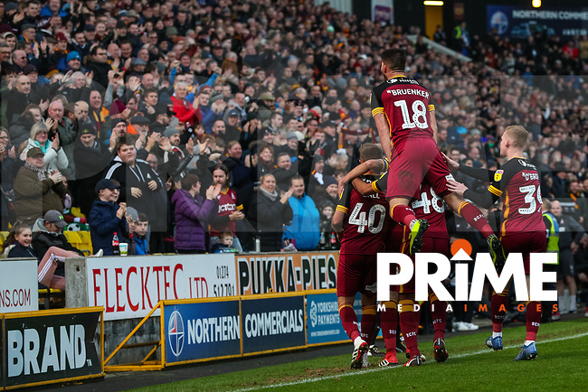 David Ball of Bradford City celebrates scoring with his team mates in front of a busy Valley Parade during the Sky Bet League 1 match between Bradford City and Oxford United at the Northern Commercial Stadium, Bradford, England on 24 November 2018. Photo by Thomas Gadd.
