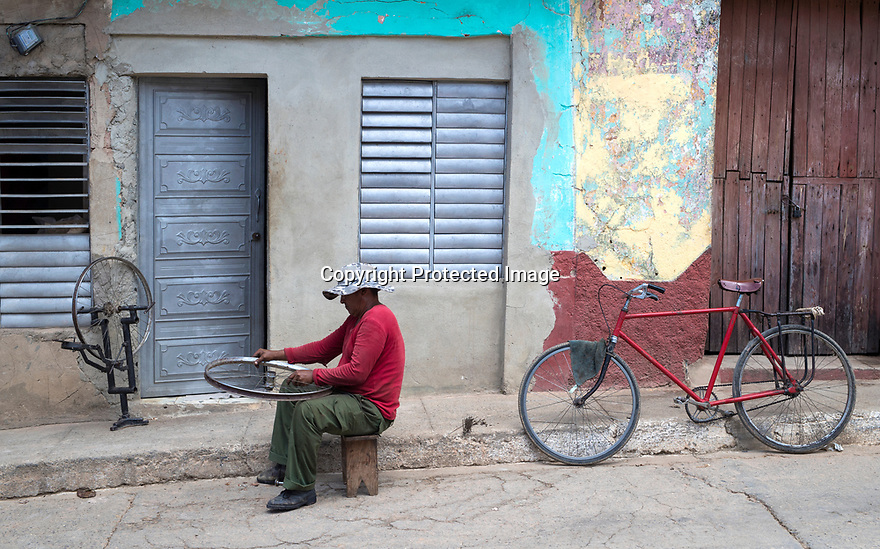 27/07/18<br /> <br /> A man fixes bicycle wheels, Trinidad, Cuba.<br /> <br /> All Rights Reserved, F Stop Press Ltd. (0)1335 344240 +44 (0)7765 242650  www.fstoppress.com rod@fstoppress.com