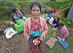 Maria Oralia Jiguan shows her share of the eggs produced in a women's cooperative poultry raising project in Buena Vista Bacchuc, a small Mam-speaking Maya village in Comitancillo, Guatemala. The project is assisted by the Maya Mam Association for Investigation and Development (AMMID).