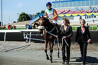 Barefoot Lady (IRE) (4) with jockey David Moran rides with her owner, Mrs. H. Steel, to the winners circle after winning the Canadian Stakes (Grade III) at Woodbine Race Course in Ontario, Canada on September 16, 2012.