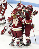 Emily Pfalzer (BC - 14), Ashley Motherwell (BC - 18), Mary Restuccia (BC - 22) - The Boston College Eagles defeated the Harvard University Crimson 4-2 in the 2012 Beanpot consolation game on Tuesday, February 7, 2012, at Walter Brown Arena in Boston, Massachusetts.
