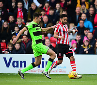 Lincoln City's Bruno Andrade vies for possession with  Forest Green Rovers' Paul Digby<br /> <br /> Photographer Andrew Vaughan/CameraSport<br /> <br /> The EFL Sky Bet League Two - Lincoln City v Forest Green Rovers - Saturday 3rd November 2018 - Sincil Bank - Lincoln<br /> <br /> World Copyright &copy; 2018 CameraSport. All rights reserved. 43 Linden Ave. Countesthorpe. Leicester. England. LE8 5PG - Tel: +44 (0) 116 277 4147 - admin@camerasport.com - www.camerasport.com