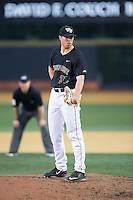 Wake Forest Demon Deacons relief pitcher Chris Farish (32) looks to his catcher for the sign against the Clemson Tigers at David F. Couch Ballpark on March 12, 2016 in Winston-Salem, North Carolina.  The Tigers defeated the Demon Deacons 6-5.  (Brian Westerholt/Four Seam Images)