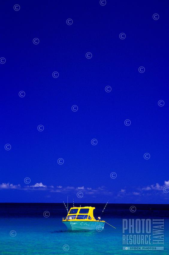 Fishing boat anchored off the sandbar in  Kaneohe Bay, Oahu