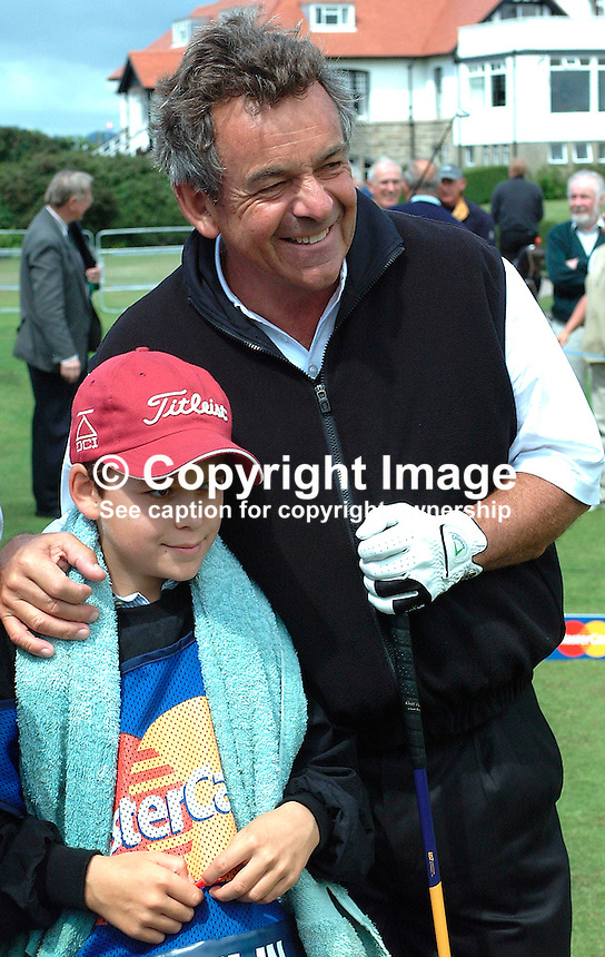 Tony Jacklin, professional golfer, England, with son, Sean, who was his caddy.  Ref: 200207230009. Photograph taken at ProAm prior to British Seniors Golf Championship at Royal County Down, N Ireland...Copyright Image from Victor Patterson, 54 Dorchester Park, Belfast, UK, BT9 6RJ..Tel: +44 28 9066 1296.Mob: +44 7802 353836.Voicemail +44 20 8816 7153.Skype: victorpattersonbelfast.Email: victorpatterson@mac.com.Email: victorpatterson@ireland.com (back-up)..IMPORTANT: If you wish to use this image or any other of my images please go to www.victorpatterson.com and click on the Terms & Conditions. Then contact me by email or phone with the reference number(s) of the image(s) concerned.