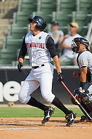 Jose Vargas #13 of the Kannapolis Intimidators follows through on his swing against the Hagerstown Suns at Fieldcrest Cannon Stadium August 8, 2010, in Kannapolis, North Carolina.  Photo by Brian Westerholt / Four Seam Images