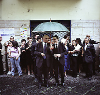 People gather outside a wedding waiting for the bride and groom in Marigliano, Italy, in June 2010...PHOTOS/ MATT NAGER