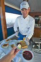Caribbean cruise with Sea Cloud II. Patissier Dirk Neubu?sser serves cre?pes during the afternoon tea.