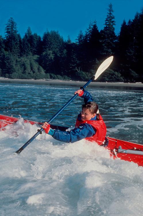 Surf Kayaking, Woman sea kayaker riding Pacific surf, Shi Shi Beach, Olympic National Park, Olympic Peninsula, Washington State, Pacific Northwest, USA,.