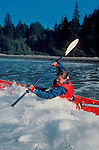 Surf Kayaking, Woman sea kayaker riding Pacific surf, Shi Shi Beach, Olympic National Park, Olympic Peninsula, Washington State, Pacific Northwest, USA,.