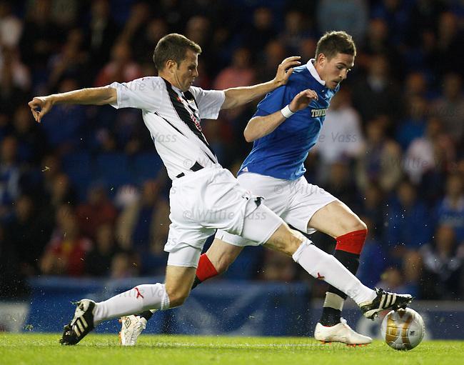 Kyle Lafferty breezes past the challenge of Chris Higgins en route to scoring Rangers goal no 2