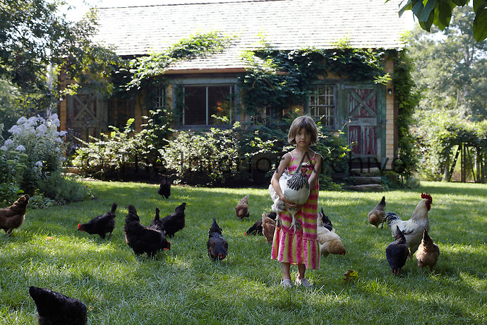 Alice tends to the hens in the garden