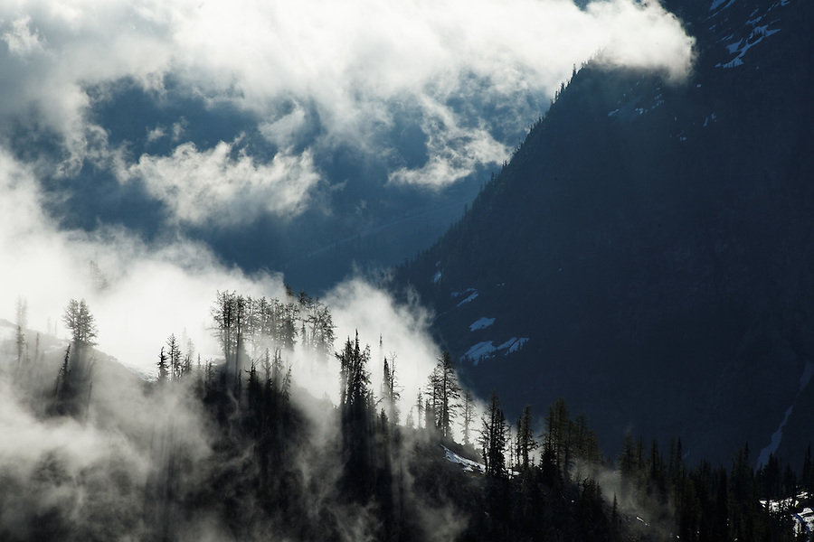 Clouds and stormy weather pour through vallies and over ridges, near Maple Pass, North Cascades, Washington, USA