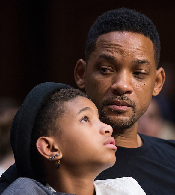 "UNITED STATES - JULY 16: Actor Will Smith and his daughter Willow Smith sit in the audience as his wife Jada Pinkett Smith testifies during the Senate Foreign Relations Committee hearing on ""The Next Ten Years in the Fight Against Human Trafficking: Attacking the Problem with the Right Tools"" on Tuesday, July 17, 2012. Jada Pinkett Smith is an advocate for Don't Sell Bodies. (Photo By Bill Clark/CQ Roll Call)"