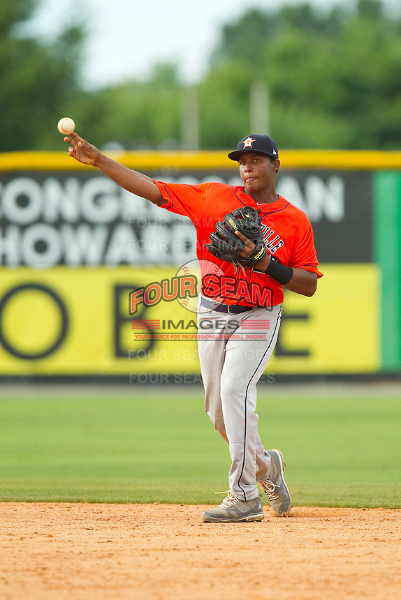 Greeneville Astros second baseman Juan Santana (27) makes a throw to first base against the Burlington Royals at Burlington Athletic Park on July 1, 2013 in Burlington, North Carolina.  The Astros defeated the Royals 7-0 in Game One of a doubleheader.  (Brian Westerholt/Four Seam Images)