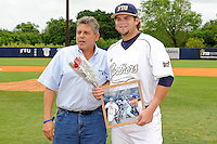 16 May 2010:  FIU's Tim Jobe (26) and family pose for a photo on the field prior to the game as FIU honored its seniors.  The FIU Golden Panthers defeated the University of South Alabama Jaguars, 5-0, at University Park Stadium in Miami, Florida.