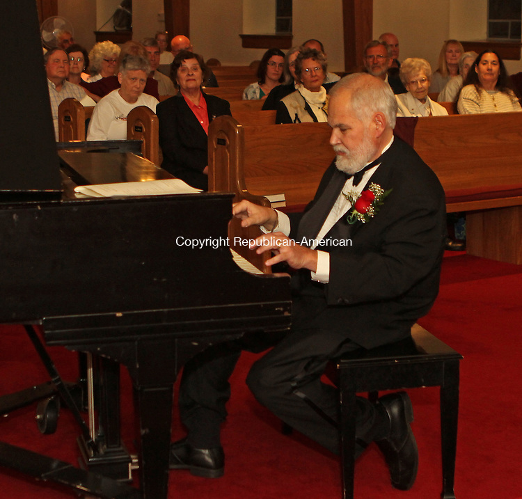 "Torrington, CT- 13 September 091314MK20 Retired Torrington Middle School music teacher Matthew Valenti performs for a benefit Saturday night at the Center Congregational Church in Torrington. Valenti played selections from ""Phantom of the Opera,"" ""Cats,"" ""Les Miserables,"" and ""West Wide Story."" Proceeds from the event will fund community activities sponsored by the church.  Michael Kabelka / Republican-American"