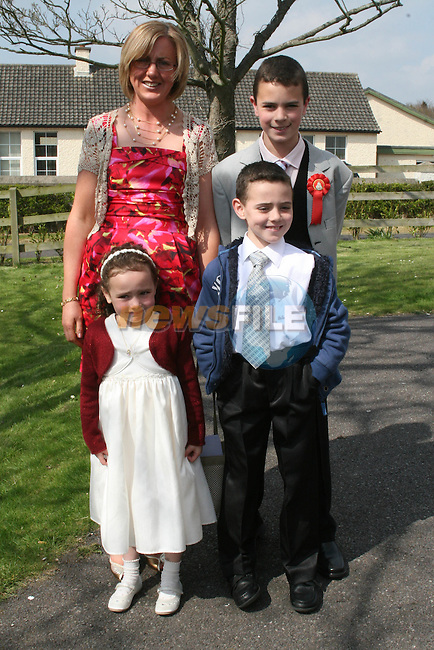 Kadar Guemboura and family at Scoil an Spioraid Naoimh NS Confirmation in Laytown Church...Photo NEWSFILE/Jenny Matthews.(Photo credit should read Jenny Matthews/NEWSFILE)....This Picture has been sent you under the condtions enclosed by:.Newsfile Ltd..The Studio,.Millmount Abbey,.Drogheda,.Co Meath..Ireland..Tel: +353(0)41-9871240.Fax: +353(0)41-9871260.GSM: +353(0)86-2500958.email: pictures@newsfile.ie.www.newsfile.ie.FTP: 193.120.102.198.