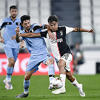 20th July 20202, Allianz Stadium, Turin, Italy; Serie A football league, Juventus versus Lazio; Paulo Dybala goes past the challenge from Danilo Cataldi