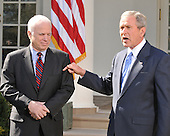 Washington, DC - March 5, 2008 -- United States President George W. Bush, right, makes a statement in the Rose Garden of the White House endorsing United States Senator John McCain (Republican of Arizona), left, the presumptive 2008 Republican nominee for President of the United States on Wednesday, March 5, 2008..Credit: Ron Sachs / CNP