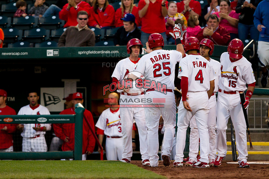 Matthew Adams (25) of the Springfield Cardinals is congratulated after hitting a home run during a game against the Tulsa Drillers on April 29, 2011 at Hammons Field in Springfield, Missouri.  Photo By David Welker/Four Seam Images.
