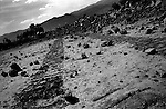 Near Kalooshah, South Waziristan, april 2004: Bulldozer tracks and demolished homes.  The Pakistan army bulldozed dozens of homes it claimed belonged to men they accused of harbouring Al Qaeda fighters.  The locals dispute these accusations. Many innocent civilians have lost their homes, water wells and pumps and have had to flee into the mountains or to hastily set up camps.