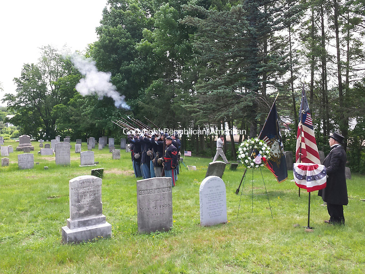 """TORRINGTON, CT- 14 June 2014- 061414BJ02-- Civil War re-enactors portraying Union soldiers fire their firearms during a dedication of a headstone for Pryce Lewis, a spy who helped the Union Army during the Civil War. The late Wilber """"Willi"""" Runk of Bristol portrayed Lewis. Friends of Runk raised money to put a headstone where Lewis is believed to be buried at Center Cemetery behind City Hall. Bruno Matarazzo Jr. Republican-American"""