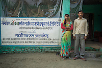 Collection centre owners and farmers Asha Devi, 23, and her husband Ganesh Kumar Singh, 30, pose for a portrait in their collection centre in Machahi village, Muzaffarpur, Bihar, India on October 27th, 2016. They rent out a part of their house to be used as a collection centre for Producer Group farmers. Non-profit organisation Technoserve works with women vegetable farmers in Muzaffarpur, providing technical support in forward linkage, streamlining their business models and linking them directly to an international market through Electronic Trading Platforms. Photograph by Suzanne Lee for Technoserve