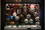 A display of historical footballs on display at the new National Football Museum in Manchester. The new museum, based in the futuristic Urbis building in the city centre of Manchester was set to open to the public on 6th July 2012. The National Football Museum, which was previously located in Preston, Lancashire, was expected to attract around 350,000 visitors each year.