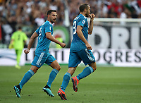 Calcio, Serie A: Parma - Juventus, Parma stadio Ennio Tardini, 24 agosto 2019. <br /> Juventus' captain Giorgio Chiellini (r) celebrates after scoring with his teammate Mattia De Sciglio (l) during the Italian Serie A football match between Parma and Juventus at Parma's Ennio Tardini stadium, August 24, 2019. <br /> UPDATE IMAGES PRESS/Isabella Bonotto