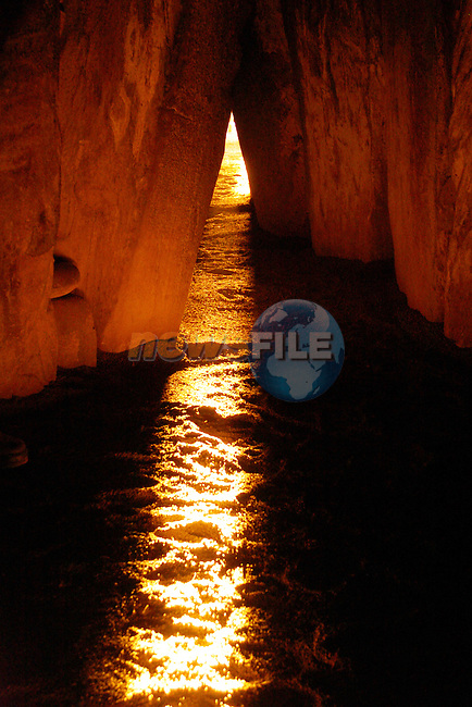 Winter Solstice at Newgrange Co Meath as the rising sun light starts to light up the burial chamber..Photo Fran Caffrey Newsfile.ie..This Picture has been sent to you by Newsfile Ltd..The Studio,.Millmount Abbey,.Drogheda,.Co. Meath,.Ireland..Tel: +353(0)41-9871240.Fax: +353(0)41-9871260.ISDN: +353(0)41-9871010.www.newsfile.ie..general email: pictures@newsfile.ie