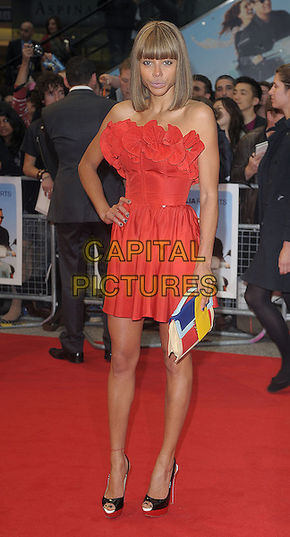 Ana Araujo.attending The World Premiere of 'Larry Crowne', Vue Westfield, London, England, UK, 6th June 2011..full length dress hand on hip clutch bag peep toe platform black shoes strapless red ruffle .CAP/BEL.©Tom Belcher/Capital Pictures.