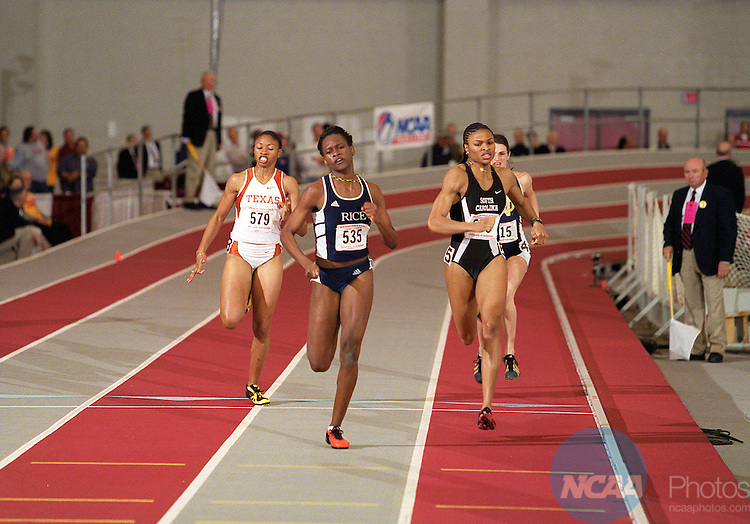 09 MAR 2002:  Allison Beckford (535) of Rice races to the finish of the 400 meter dash in front of Demetria Washington (555) of South Carolina and Moushaumi Robinson (579) of Texas during the Division 1 Indoor Track and Field Championships held at the Randal Tyson Track Center on the University of Arkansas campus in Fayetteville, AR.  Beckford won with a time of 52.16.   Gary Yandell/NCAA Photos