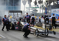 Mar. 10, 2012; Gainesville, FL, USA; NHRA crew members for top fuel dragster driver Brady Kalivoda during qualifying for the Gatornationals at Auto Plus Raceway at Gainesville. Mandatory Credit: Mark J. Rebilas-
